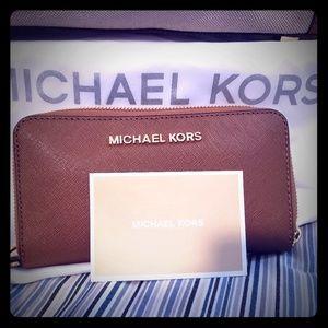 For Sale: Authentic Michael Kors brown wallet